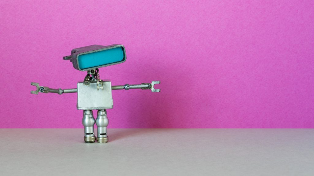 Simplified robotic computer chat bot with a large head blue screen