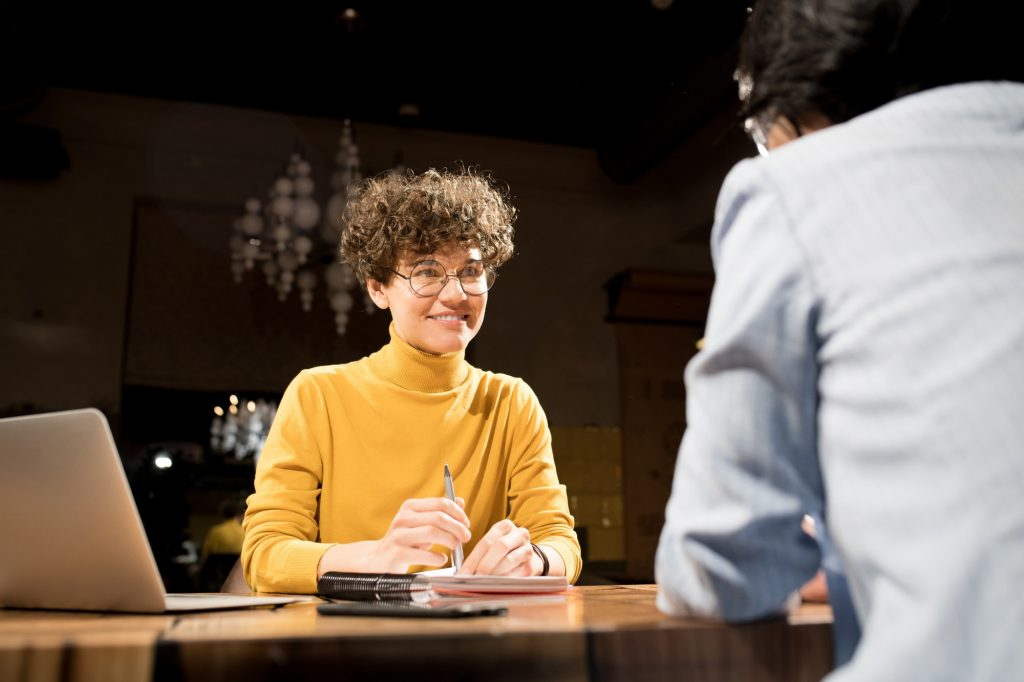 Smiling recruiter interviewing candidate